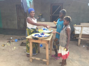 children buying from Abibata's shop