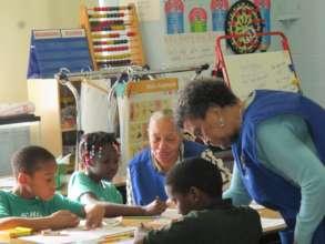 Children being mentored by Foster Grandparents
