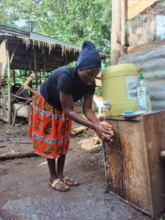 Village Woman Washing her Hands