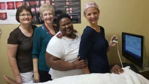 Staff Nurse, Sonja Botha (right), in training.