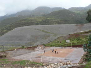 Playing soccer near the open pit mine