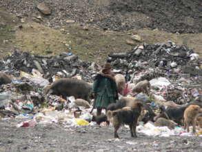 Woman among mining waste