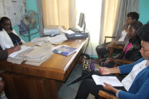 in the school head's office finalizing enrolment