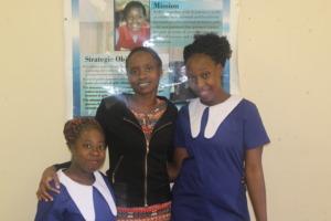 Sisters Nyengeterai and Angeline w/ FAWEZI rep Nqo