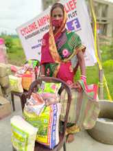 Beneficiary with food parcels
