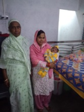 Farah, her baby and mother