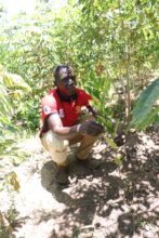 Peter, with a jackfruit tree he planted in 2018