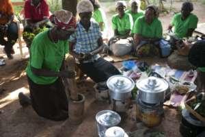 Women preparing traditional medicine