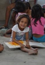 A child reading a book with Fundacion Clara Luna