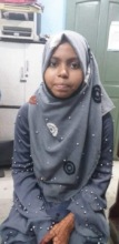 Zainab uses her smartphone to access her education