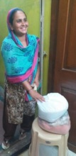 One of the mothers receiving food rations