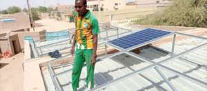 Installing solar panels on the girls' dorm