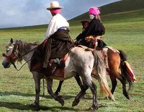 Tibetan nomad family on horseback