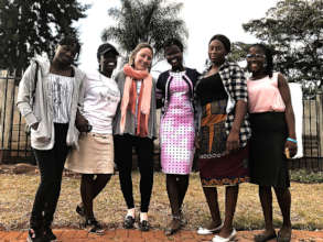 McLane with the girl ambassadors in Zimbabwe