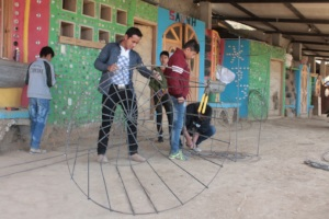 CETC students prepare the water tanks
