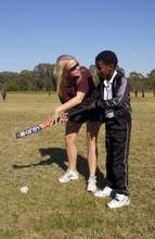 Coach Kate works with Xolelwa on her technique