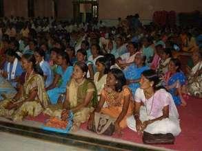 women listening to a talk
