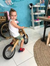 Satisfied 5 year old in his balance bike