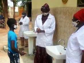 Instructing the street children about hand washing