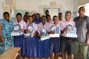 Students receiving the solar lamps