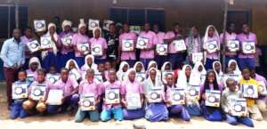 Ozi Primary Students with Solar Lanterns