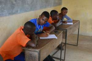 Volunteers interviewing students