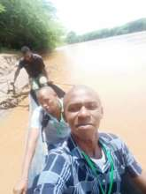 TRLF Staff crossing River Tana by canoe