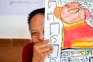 SEP student proud of his colourful drawing