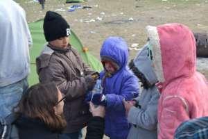 Children Receiving Fresh Drinking Water