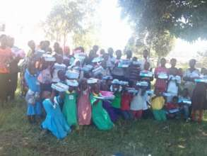 Children receive books to enable them continue sch
