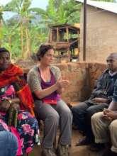 Dir of Programs Brandy Lellou talks with farmers