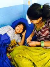 Sunita with Staff Member in Hospital