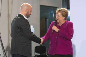 Country Director Gal with Chancellor Merkel