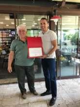 Mr.Yalcn is getting certificate from Mr.Aygunduz