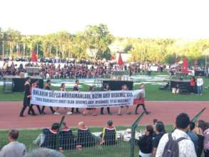 Scholarship holders carried banner during ceremony