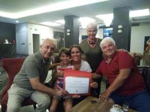 Mrs.Senol gets her donation certificate