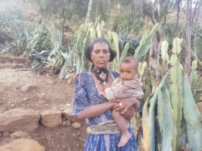 Tree planting worker Weresech with her child