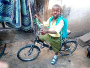 Hudu, age 10, with his new bicycle