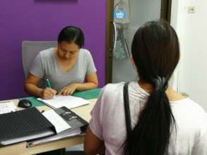 Staff does intake Interview with new woman