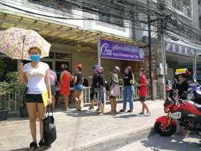 Line of women waiting at Tamar for food