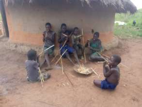 Children eating dry sorghum stalks