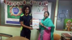 Dr. Sarita presenting artwork to Chaitanya