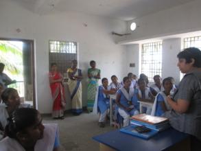 Mrs. Nishka Crishna, with student and teachers