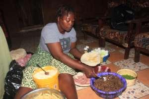 Fatmata making food at her business