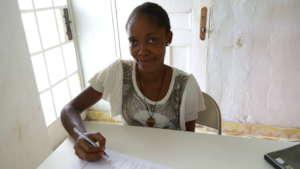 Katimu receiving a microfinance loan