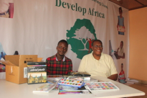 Sahr with Sylvester and the art supplies donated