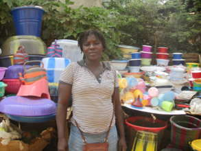 Woman retailing plastic bowls and buckets