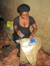 Sarah repacks the milk into small bags