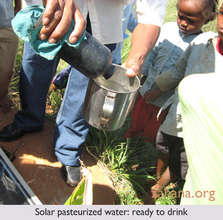 Solar pasteurized water in poured into a cup
