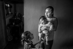 Otomi partner and her children in her home